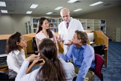 doctor having a discussion with his students